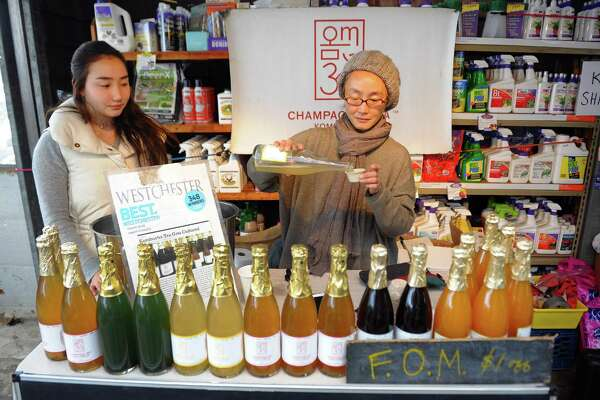 Jy Lym pours a sample of Om Champagne Tea during the Westport Winter Farmers' Market at Gilbertie's Herb and Garden Center on Sylvan Lane in Westport, Conn. on Saturday Dec. 30, 2017. The market runs through March 10th on each Saturday from 10:00AM - 2:00PM.