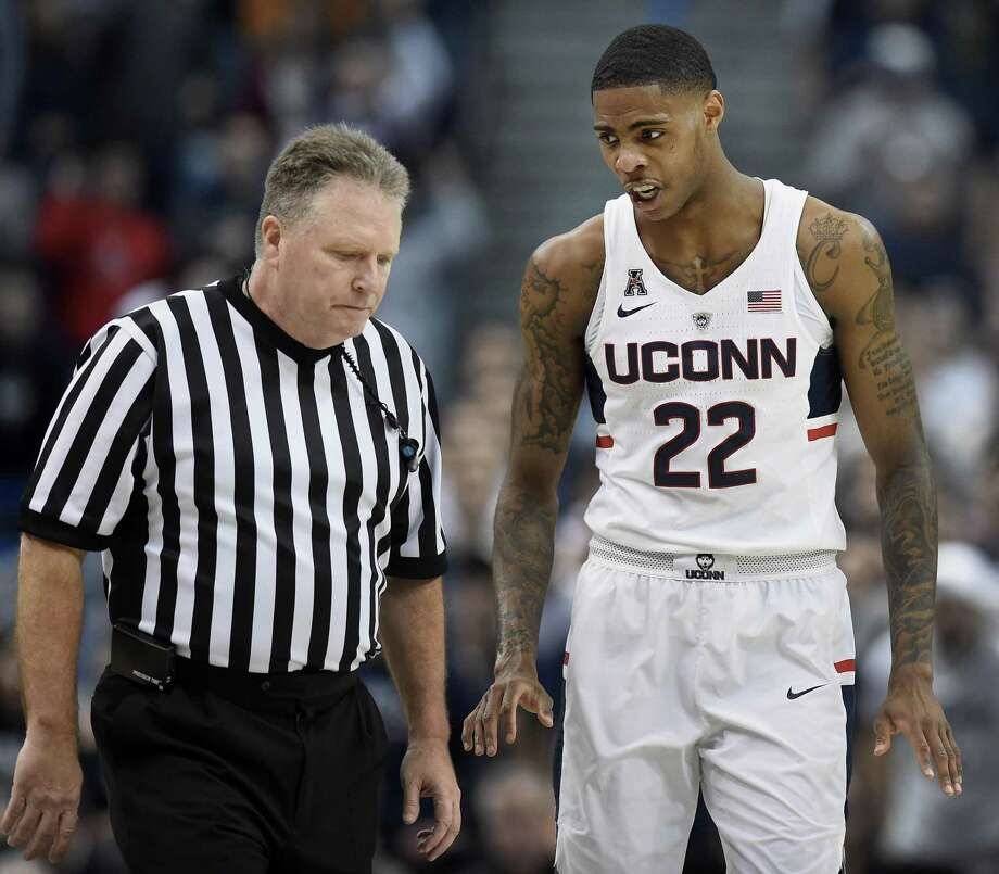 UConn's Terry Larrier, right, discusses a foul against him with official Karl Hess during the first half against Wichita State on Saturday in Hartford. Photo: Jessica Hill / Associated Press / AP2017