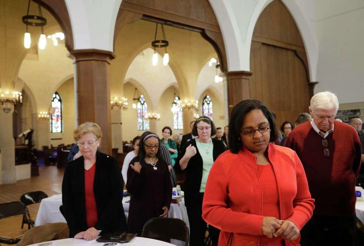 People pray at Trinity Episcopal Church, 1015 Holman St., shown during their Cornerstone Centennial Celebration Sunday, Dec. 17, 2017, in Houston. ( Melissa Phillip / Houston Chronicle )