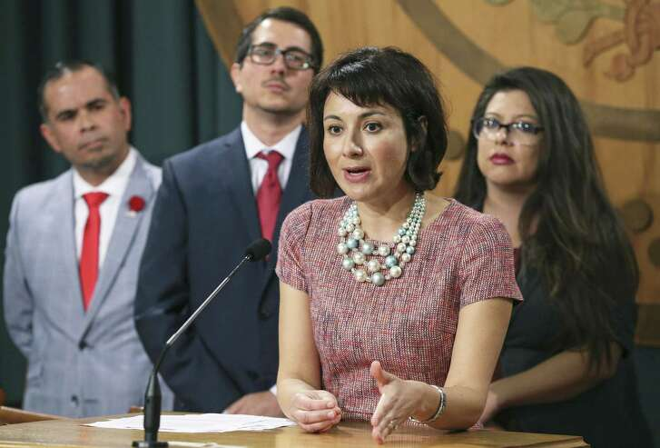 Rep. Gina Hinojosa, D-Austin, makes a point as members of the Mexican American Legislative Caucus speak at the Capitol stating their views of recent governmental action regarding DACA and SB4 in Texas on September 13, 2017.