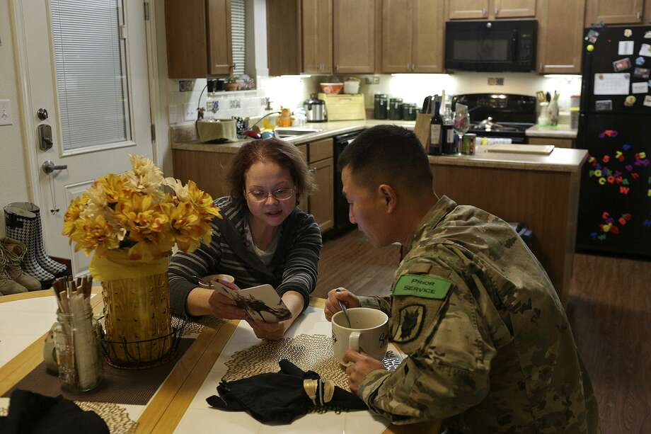 Cassie Kim talks to her husband, Jongman Kim, about their plans for the evening at their East Meadows apartment in San Antonio on Dec. 15, 2017. Photo: SAN ANTONIO EXPRESS-NEWS / SAN ANTONIO EXPRESS-NEWS / SAN ANTONIO EXPRESS-NEWS