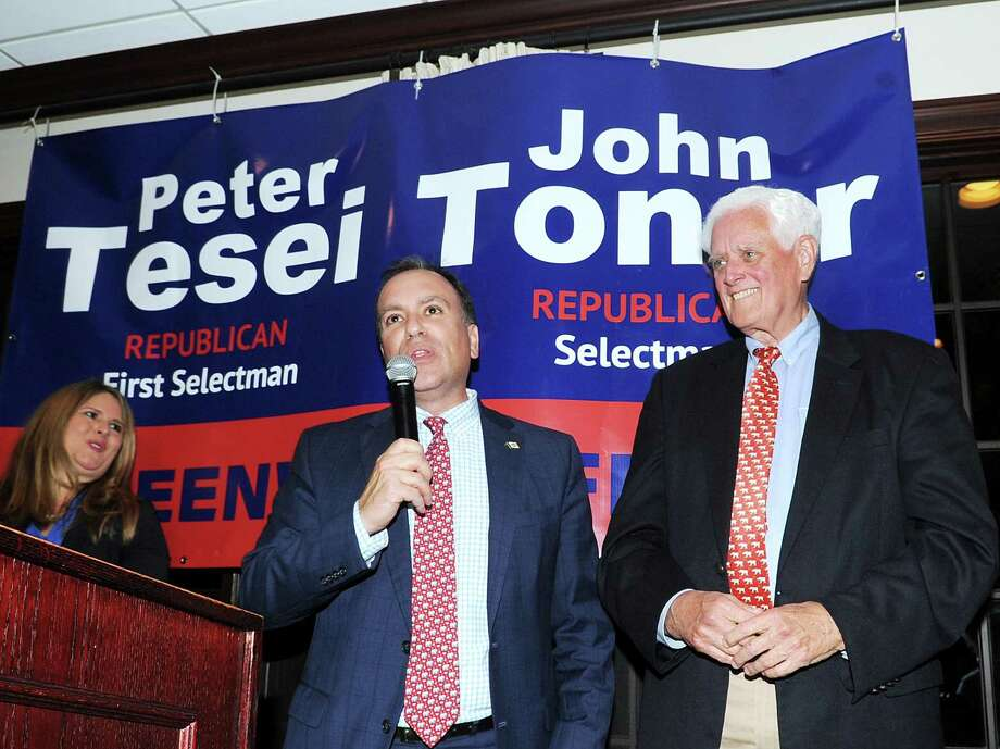 Greenwich First Selectman Peter Tesei, a Republican, center, with Selectman John Toner, also a Republican, right, celebrate their election night victory at the Milbrook Club in Greenwich, Conn., Tuesday night, Nov. 7, 2017. Photo: Bob Luckey Jr. / Hearst Connecticut Media / Greenwich Time