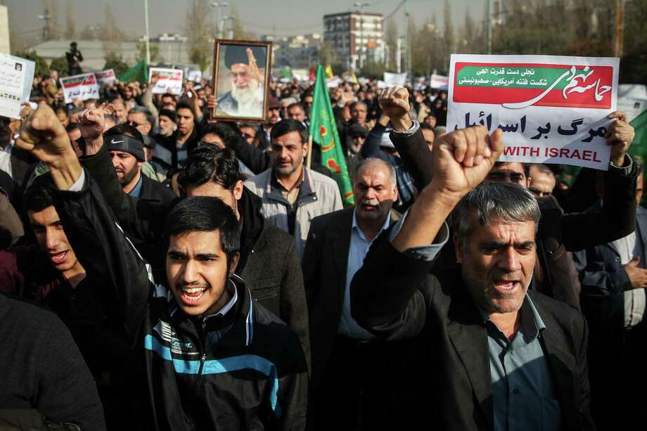 In a counter-demonstration, Iranians chant Saturday as they march in support of the government near the Imam Khomeini grand mosque in Tehran. Photo: HAMED MALEKPOUR, Contributor / AFP