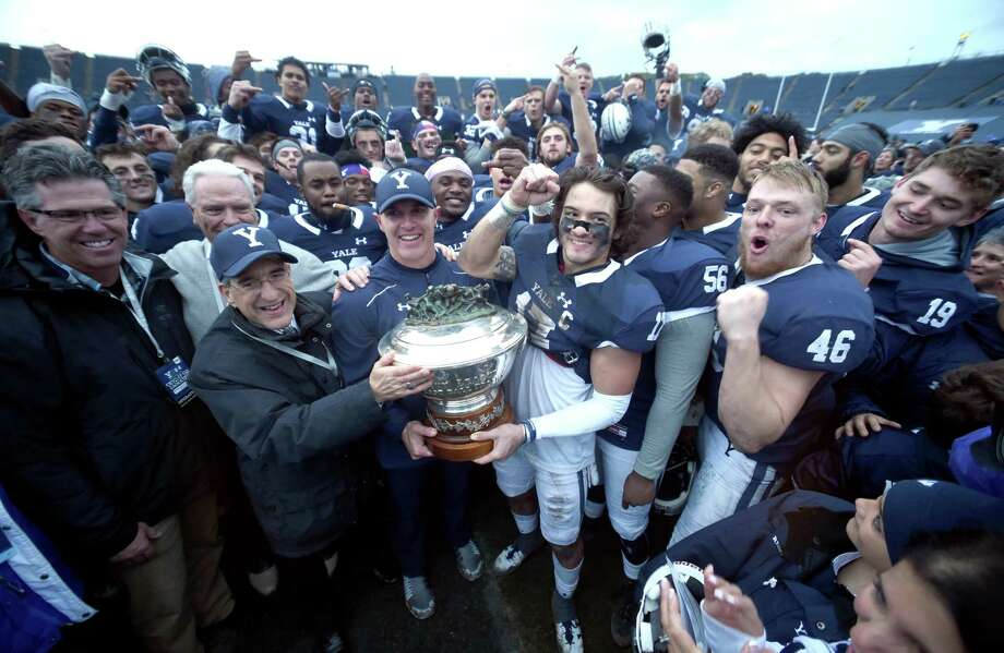 Members of the Yale football team celebrate after winning the Ivy League title outright for the first time since 1980. Photo: Arnold Gold / Hearst Connecticut Media / New Haven Register