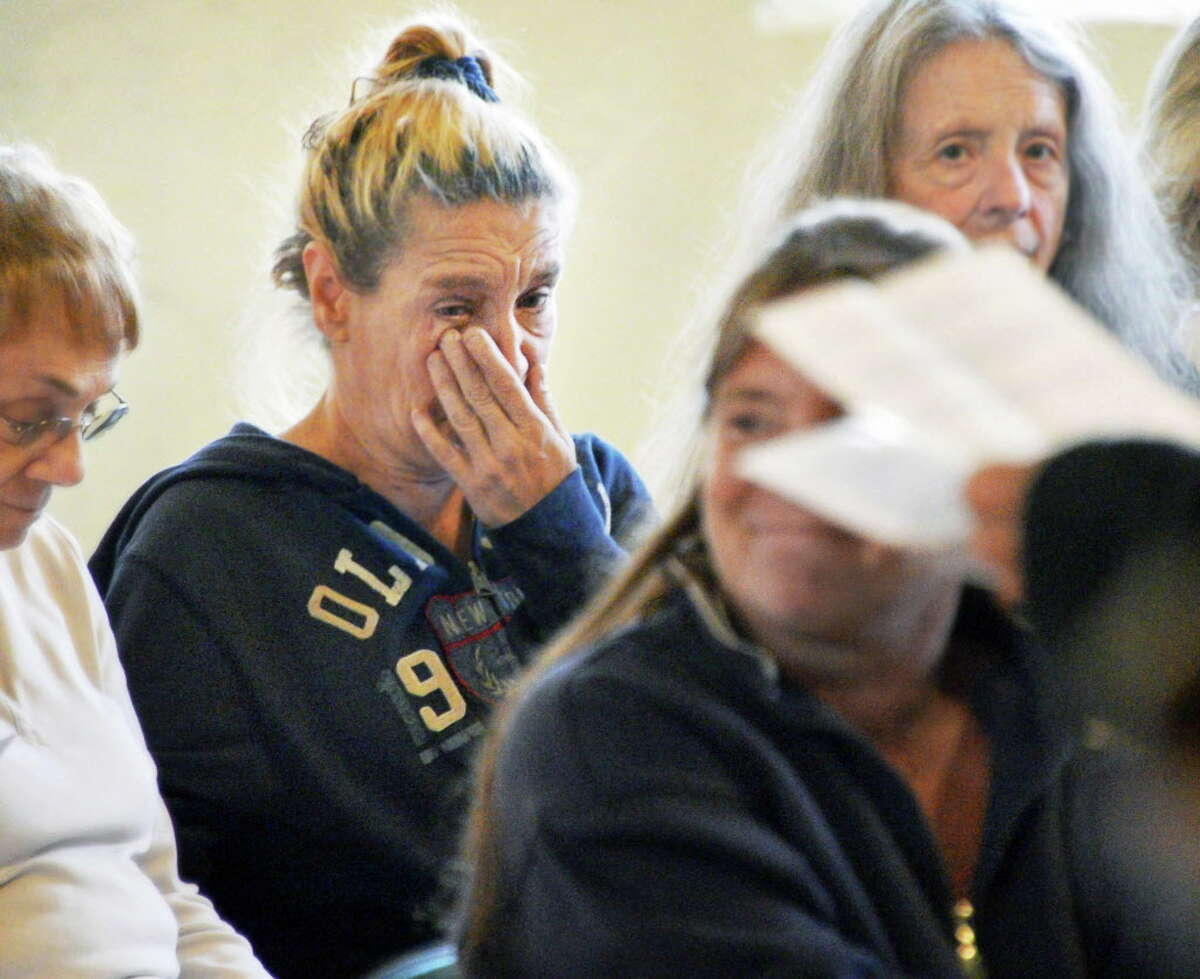 Karen Vonnegut wipes a tear during a memorial service for her friend Marc Douglas, a homeless man who was stabbed to death last June, during a service at the Grand Street Community Arts Center Saturday Sept. 2, 2017 in Albany, NY. (John Carl D'Annibale / Times Union)