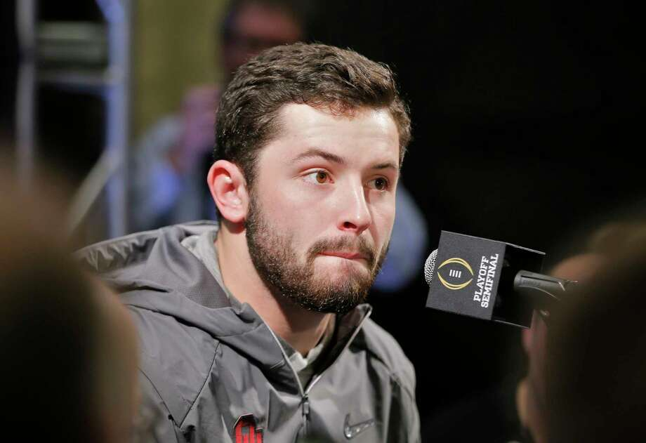Oklahoma quarterback Baker Mayfield answers questions during his team's media appearance, Saturday, Dec. 30, 2017. Mayfield participated in team media day activities after arriving late to the event. He reportedly has been recovering from the flu over Christmas break. He missed the trip to Disneyland on Wednesday with the illness and another event on Friday. Oklahoma plays Georgia in an NCAA college football semifinal playoff game at the Rose Bowl on Monday, Jan. 1, 2018. (Bob Andres/Atlanta Journal-Constitution via AP) Photo: Bob Andres, MBO / 2017 Atlanta Journal Constitution