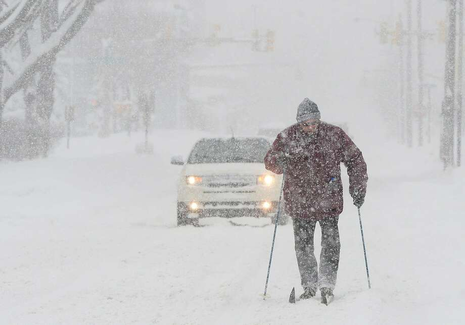 It's not just the South getting colder. Timothy Gigone, 51, of Erie, Pa., skis Saturday on Sassafras Street.  Several inches of snow were expected in Erie, under a lake effect snow warning. Photo: Jack Hanrahan, MBI / Erie Times-News