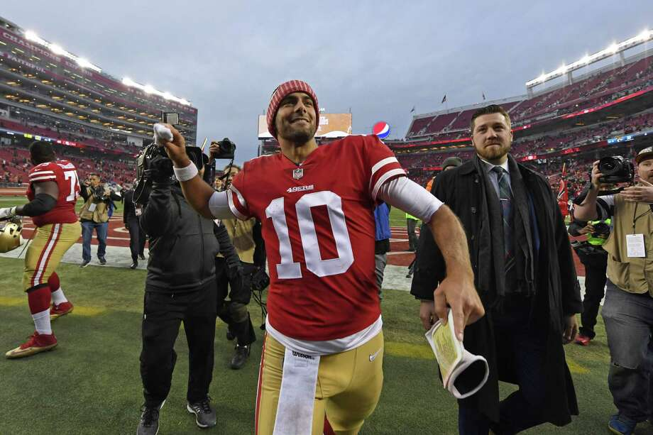 San Francisco 49ers quarterback Jimmy Garoppolo tosses his wristbands into the stands as he walks off the field after defeating the Jacksonville Jaguars last week. Photo: Jose Carlos Fajardo / Bay Area News Group / San Jose Mercury News