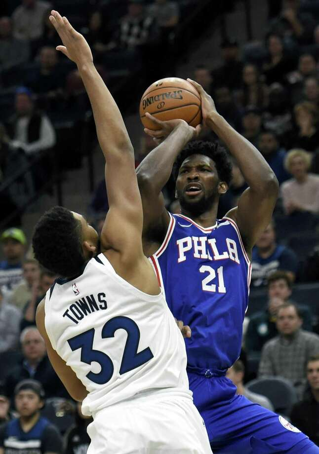 Minnesota Timberwolves center Karl-Anthony Towns (32) guards Philadelphia 76ers center Joel Embiid (21), of Cameroon, during the first quarter of an NBA basketball game on Tuesday, Dec. 12, 2017, in Minneapolis. Towns was called for a foul on the play. Photo: Hannah Foslien / AP / FR159563 AP