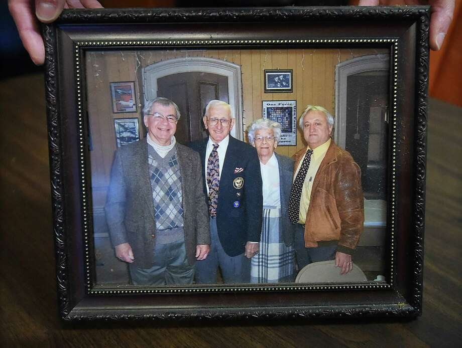 """A photograph from the wall in the bar room at the Catholic War Veteran's Hall at 112 Derby Avenue in Derby shows World War II veteran Leonard """"Lindy"""" Witek, pictured at left, Saturday, Dec. 30, 2017. Photo: Catherine Avalone, Hearst Connecticut Media / New Haven Register"""