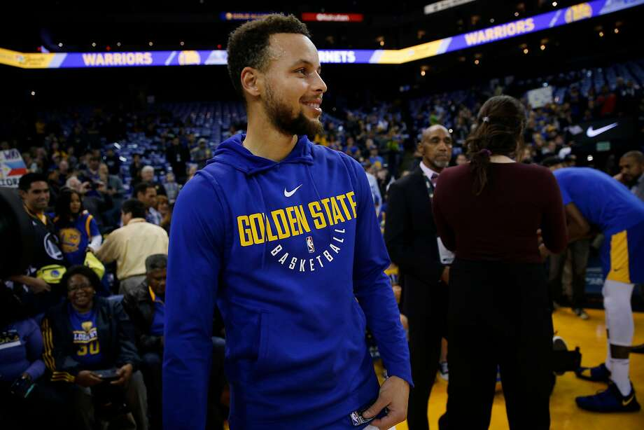 Golden State Warriors guard Stephen Curry (30) during warm up before the start of an NBA basketball game between the Golden State Warriors and Charlotte Hornets at Oracle Arena, Friday, Dec. 29, 2017 in Oakland, Calif. Curry is recovering from injury and is expected to not play this game. Photo: Santiago Mejia, The Chronicle