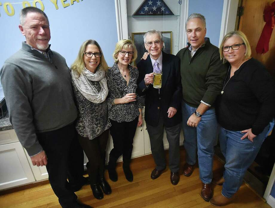 """World War II veteran Leonard """"Lindy"""" Witek celebrates his 90th birthday, Saturday, Dec. 30, 2017, with his son-in-law Steve Patten, daughter Susan Patten, daughter-in-law, Kathy Witek, son, John Witek and daughter Mary Witek at the Catholic War Veteran's Hall at 112 Derby Avenue in Derby. Photo: Catherine Avalone, Hearst Connecticut Media / New Haven Register"""