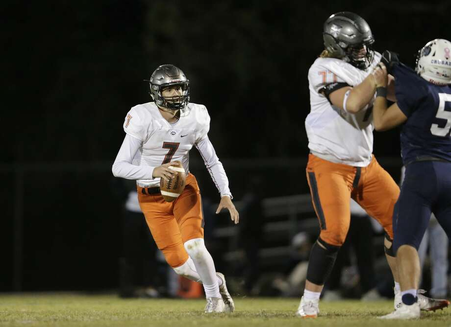 St. Pius X Panthers quarterback Grant Gunnell (7) looks to pass as tackle McKade Mettauer (77) blocks a Concordia Lutheran Crusaders defender in the second half during the high school football game between St. Pius X Panthers and the Concordia Lutheran Crusaders in Tomball, TX on Friday, October 27, 2017. Photo: Tim Warner/For The Chronicle