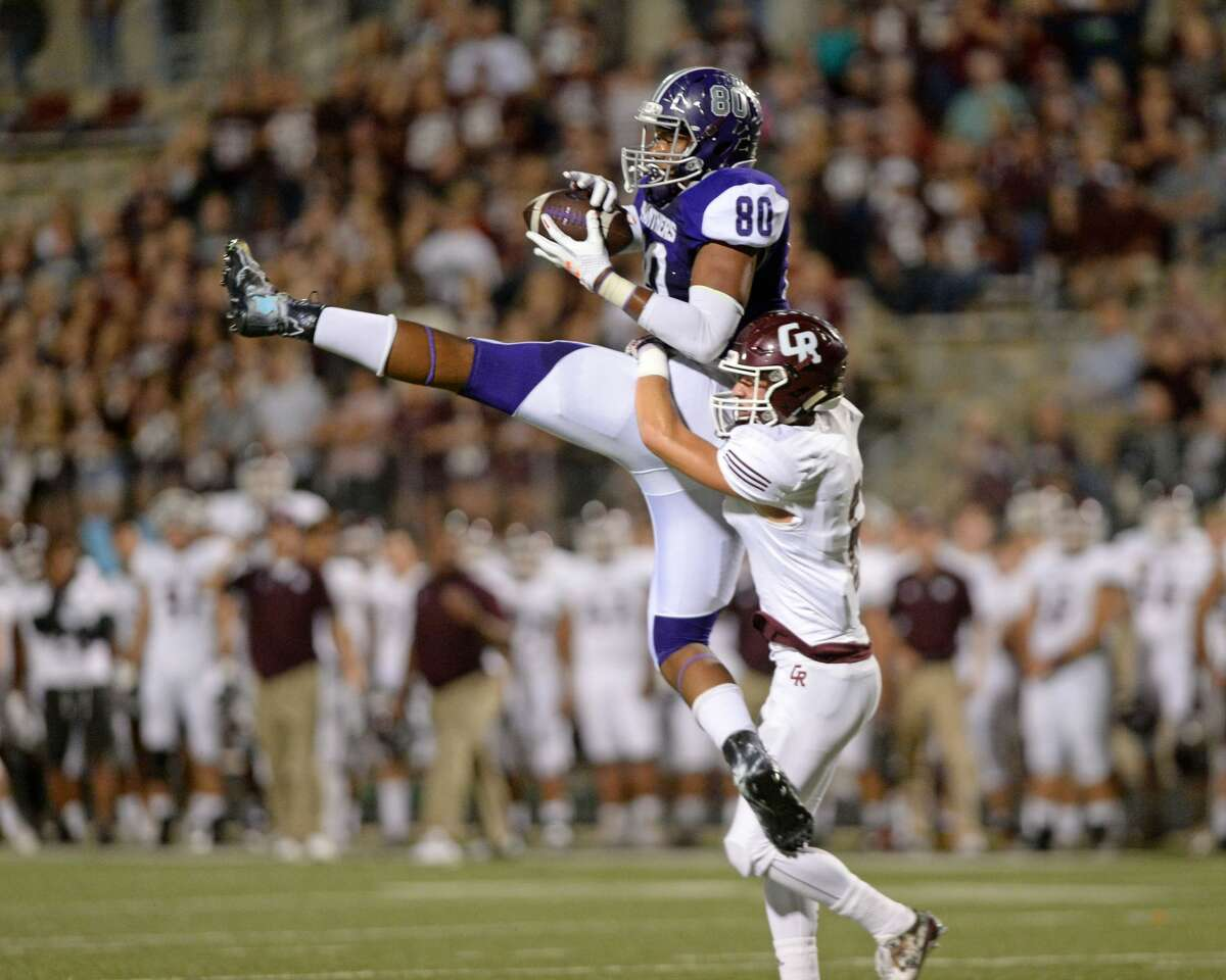 Mustapha Muhammad (80) of Ridge Point makes a reception to set-up a field goal in the second quarter of a 6A-III bi-district playoff football game between the Cinco Ranch Cougars and the Ridge Point Panthers on November 17, 2017 at Hall Stadium, Missouri City, TX.