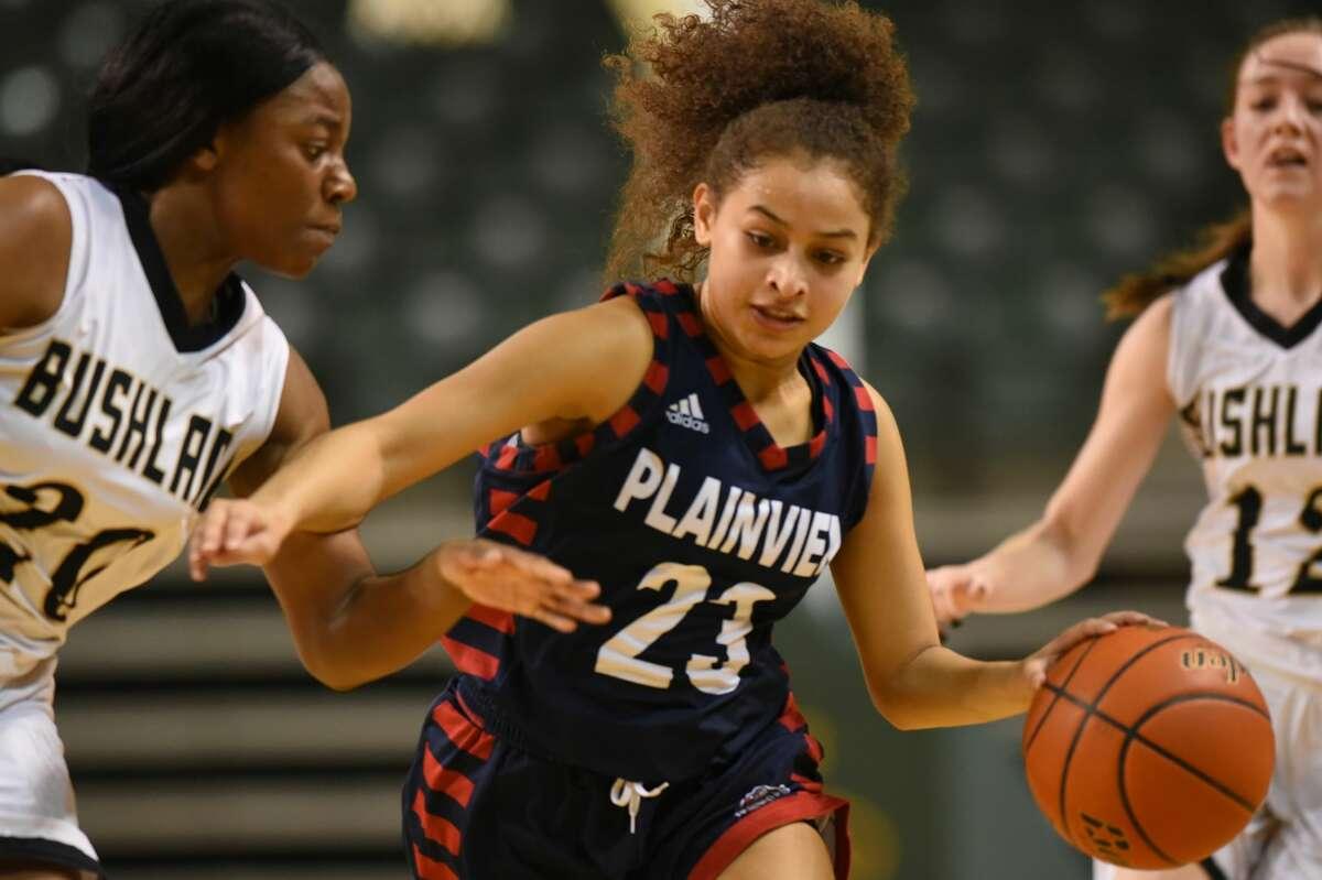 Plainview's Osen Ellis (23) dribbles against Bushland's Adriane Jackson (20) in the Byron Johnston Holiday Classic girls championship game Dec. 30, 2017, at Chaparral Center. James Durbin/Reporter-Telegram