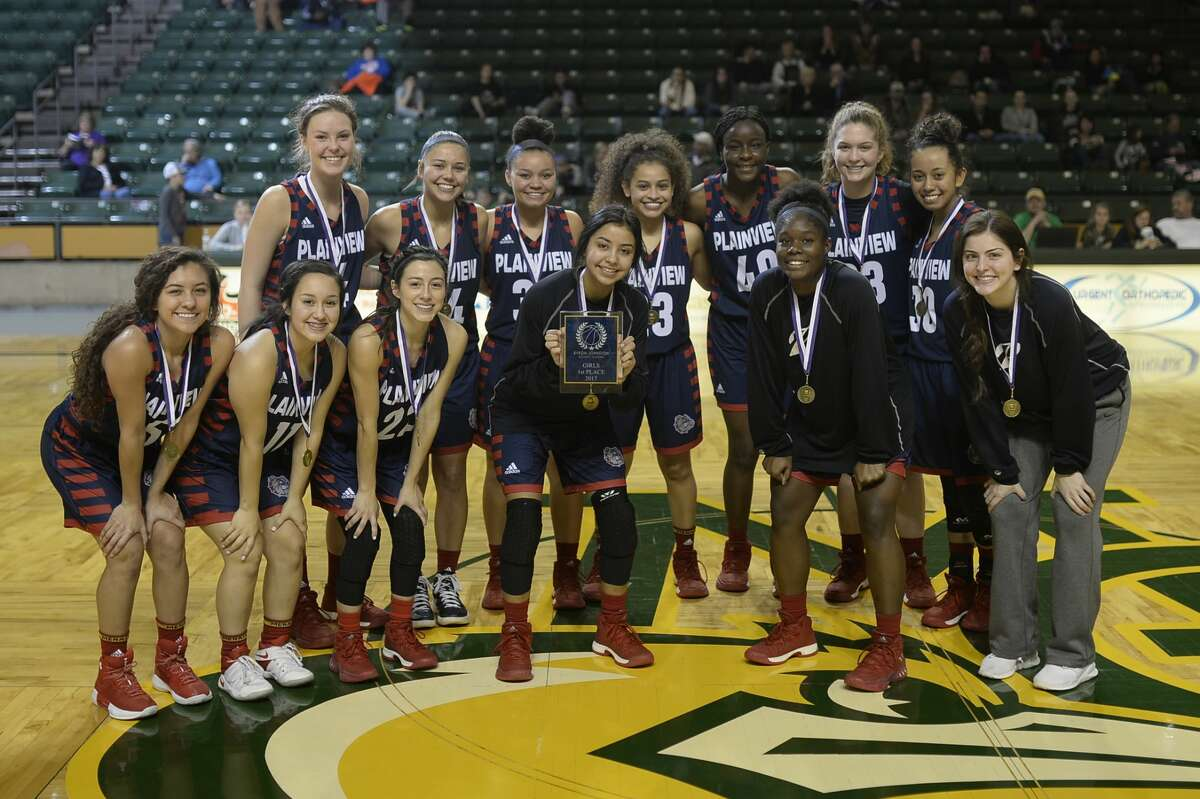 The Plainview girls basketball team celebrates a win against Bushland in the Byron Johnston Holiday Classic girls championship game Dec. 30, 2017, at Chaparral Center. James Durbin/Reporter-Telegram