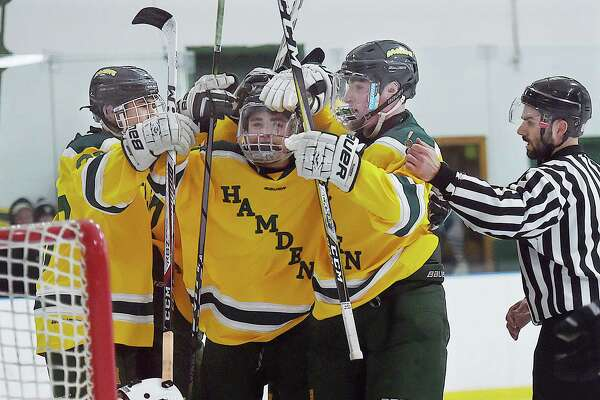 The Green Dragons celebrate their fifth goal of the game by junior forward Mike Gethings against Falcons goalie Jake Woznyk defeating Xavier, 7-4, Saturday, Dec. 30, 2017, at Astorino Rink in Hamden.