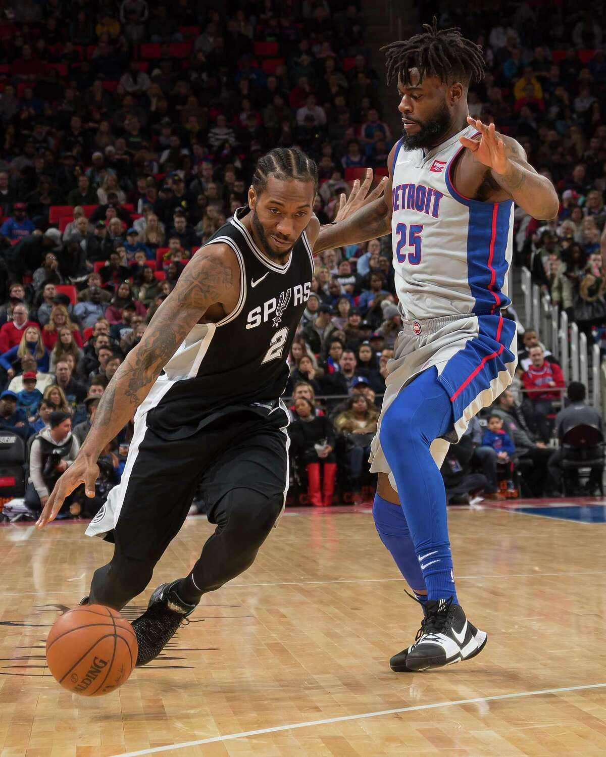 DETROIT, MI - DECEMBER 30: Reggie Bullock #25 of the Detroit Pistons defends against Kawhi Leonard #2 of the San Antonio Spurs in the first half of an NBA game at Little Caesars Arena on December 30, 2017 in Detroit, Michigan. NOTE TO USER: User expressly acknowledges and agrees that, by downloading and or using this photograph, User is consenting to the terms and conditions of the Getty Images License Agreement.