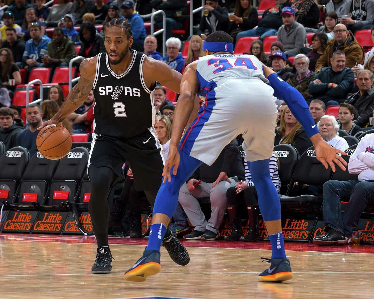 DETROIT, MI - DECEMBER 30: Tobias Harris #34 of the Detroit Pistons defends against Kawhi Leonard #2 of the San Antonio Spurs in the first half of an NBA game at Little Caesars Arena on December 30, 2017 in Detroit, Michigan. NOTE TO USER: User expressly acknowledges and agrees that, by downloading and or using this photograph, User is consenting to the terms and conditions of the Getty Images License Agreement.