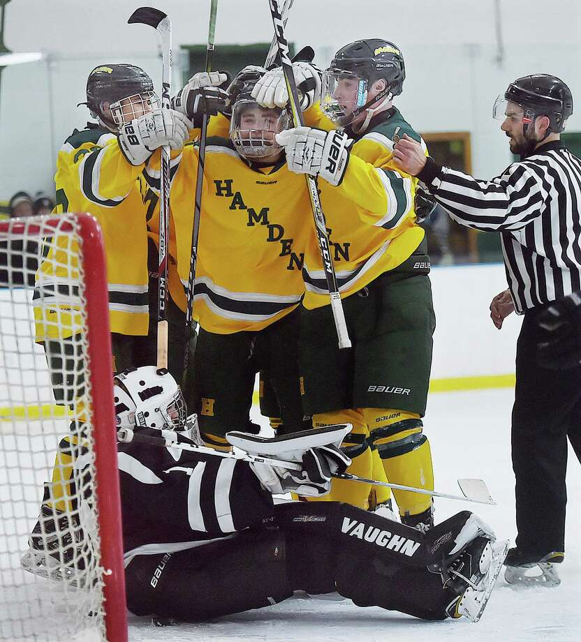 Hamden palyers celebrate their fifth goal of the game by junior forward Mike Gethings on Saturday. Photo: Catherine Avalone / Hearst Connecticut Media / New Haven Register
