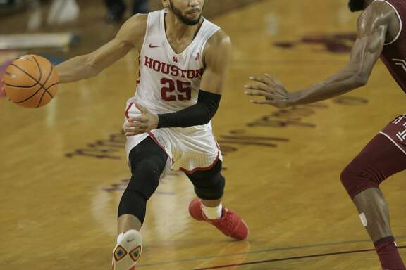 Houston Cougars guard Galen Robinson Jr. (25) drives up the court during NCAA basketball game action against the Temple Owls at TSU's H&PE Arena on Saturday, Dec. 30, 2017, in Houston. Houston won the game 76-73. ( Elizabeth Conley / Houston Chronicle )