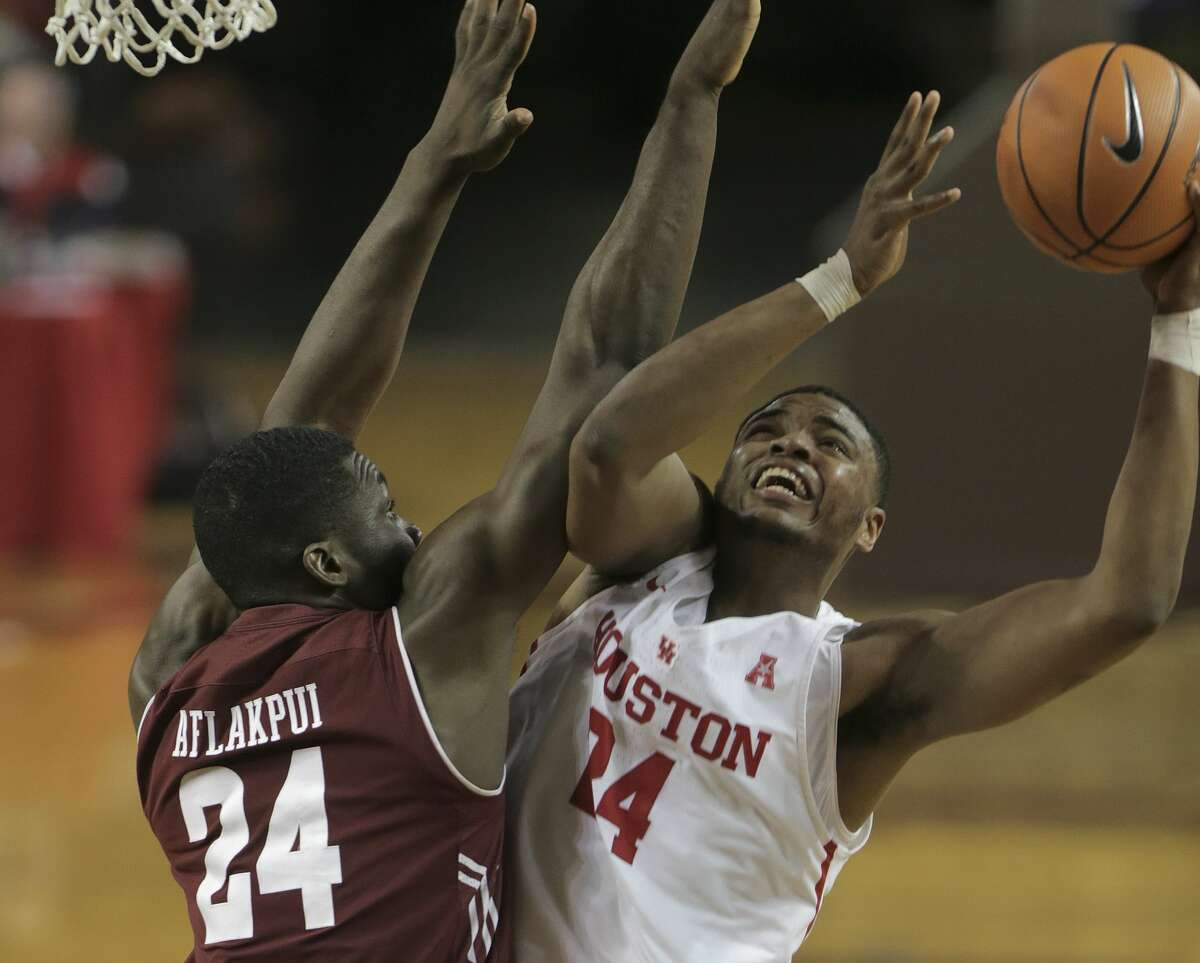 Houston Cougars forward Breaon Brady (24) puts up two around Temple Owls center Ernest Aflakpui (24) in the second half at TSU's H&PE Arena on Saturday, Dec. 30, 2017, in Houston. Houston won the game 76-73. ( Elizabeth Conley / Houston Chronicle )