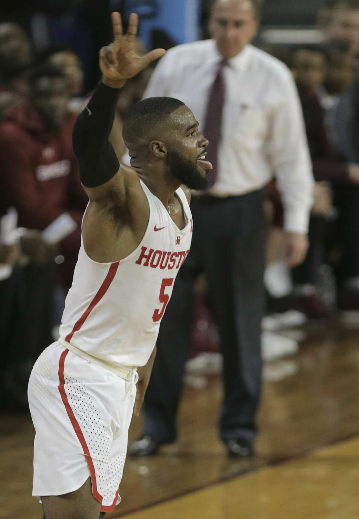 Houston Cougars guard Corey Davis Jr. (5) reacts after sinking a three-point shot in the second half against Temple Owls at TSU's H&PE Arena on Saturday, Dec. 30, 2017, in Houston. Davis had 12 points in the team's 76-73 win. ( Elizabeth Conley / Houston Chronicle )