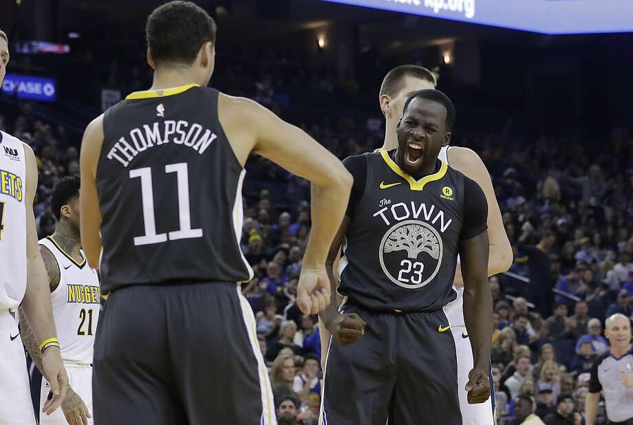 Golden State Warriors forward Draymond Green (23) reacts after scoring next to guard Klay Thompson (11) during the second half of an NBA basketball game against the Denver Nuggets in Oakland, Calif., Saturday, Dec. 23, 2017. (AP Photo/Jeff Chiu) Photo: Jeff Chiu, Associated Press