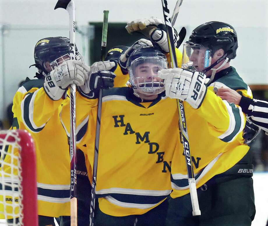 The Green Dragons celebrate following their fifth goal by junior forward Michael Gethings defeating Xavier, 7-4, Saturday, Dec. 30, 2017, at Astorino Rink in Hamden. Photo: Catherine Avalone, Hearst Connecticut Media / New Haven Register