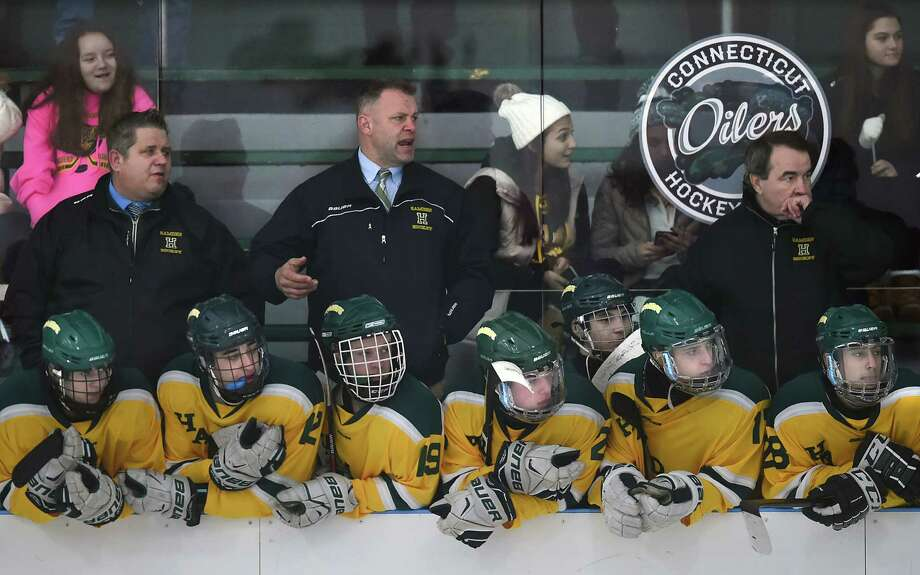 Hamden head coach Todd Hall reacts to a play, defeating Xavier, 7-4, Saturday, Dec. 30, 2017, at Astorino Rink in Hamden. Photo: Catherine Avalone, Hearst Connecticut Media / New Haven Register