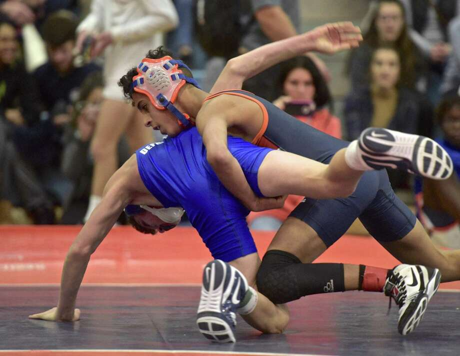 Danbury's Kevin Pina and Abbott Tech's Jake Defonce wrestle for the 99-pound weight class championship in the Ryan Sabbagh Holiday Wrestling Tournament in Danbury on Saturday. Pina won the title with a 6-0 decision. Photo: H John Voorhees III / Hearst Connecticut Media / The News-Times