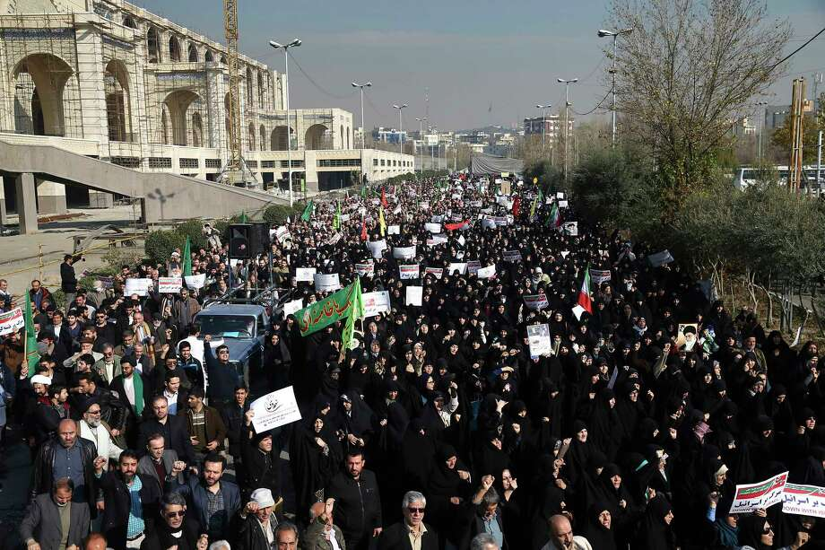 Iranian protesters chant slogans at a rally in Tehran, Iran, Saturday, Dec. 30, 2017. Iranian hard-liners rallied Saturday to support the country's supreme leader and clerically overseen government as spontaneous protests sparked by anger over the country's ailing economy roiled major cities in the Islamic Republic. (AP Photo/Ebrahim Noroozi) Photo: Ebrahim Noroozi / Copyright 2017 The Associated Press. All rights reserved.