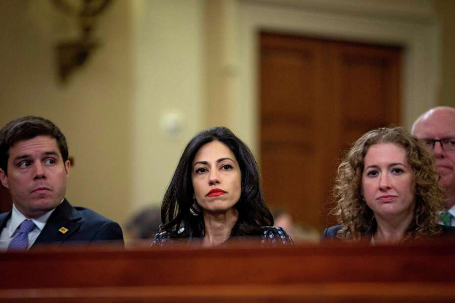 FILE -- Huma Abedin, center, at an appearance by Hilary Clinton, then secretary of state, before the House Select Committee, on Capitol Hill in Washington, Oct. 22, 2015. According to a transcript of a deposition of Abedin made public on Wednesday, June 29, 2016, the long-time aide and confidant of Hillary Clinton said that her use of the private server was never intended to sidestep federal record-keeping laws. (Doug Mills/The New York Times) ORG XMIT: XNYT147 Photo: DOUG MILLS / NYTNS