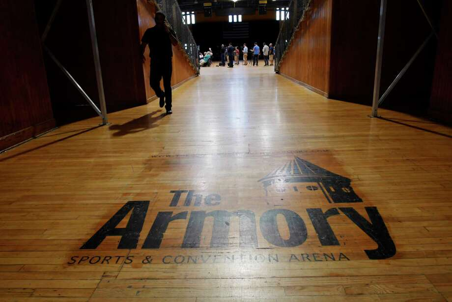 People gather inside the Washington Avenue Armory for a press conference on Wednesday, Aug. 30, 2017, in Albany, N.Y.  It was announced on Wednesday that the Albany Patroons basketball team will return to Albany as part of the North American Premiere Basketball League.      (Paul Buckowski / Times Union) Photo: PAUL BUCKOWSKI / 20041424A