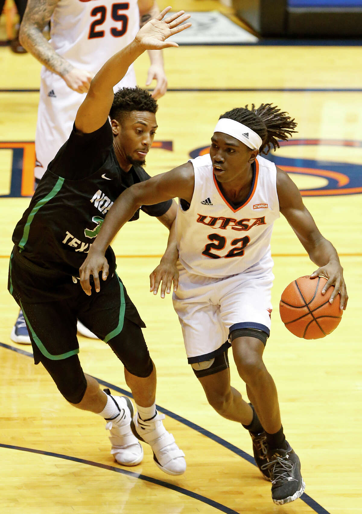 UTSA guard Keaton Wallace (22) looks for room around North Texas guard Roosevelt Smart (3) during first half action Saturday Dec. 30, 2017 at the UTSA Convocation Center.