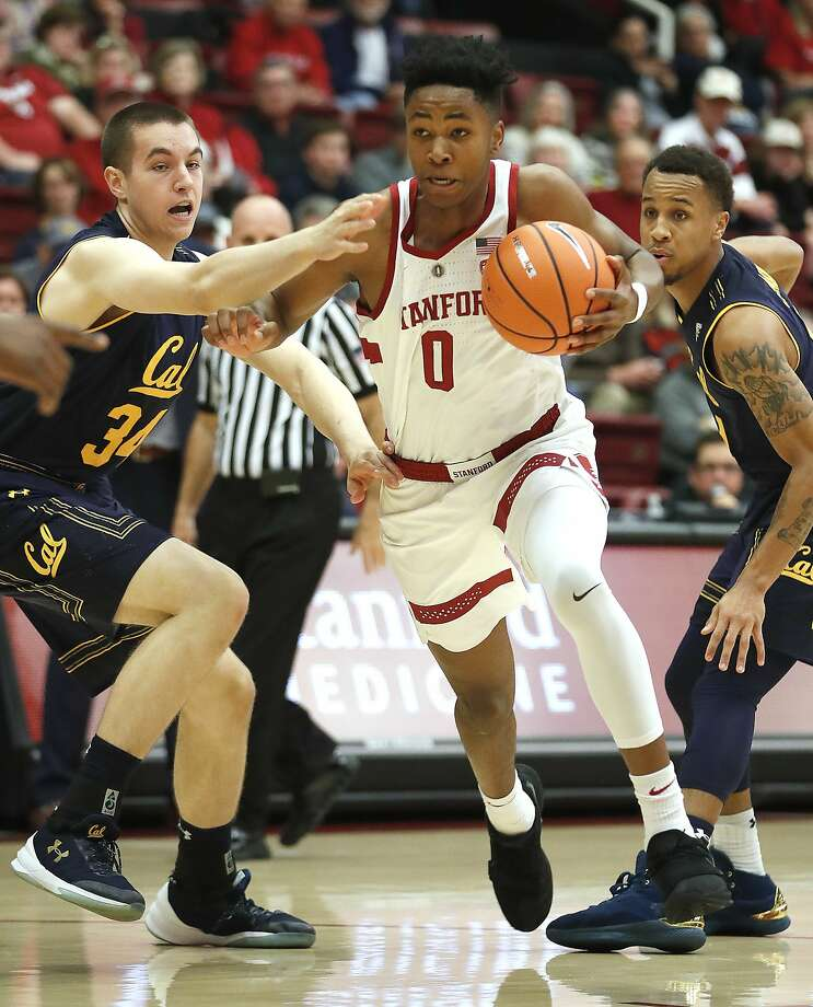 Stanford forward Kezie Okpala (0) drives to the basket past California forward Grant Anticevich (34) during the first half of an NCAA college basketball game Saturday, Dec. 30, 2017, in Stanford, Calif. (AP Photo/Tony Avelar) Photo: Tony Avelar, Associated Press
