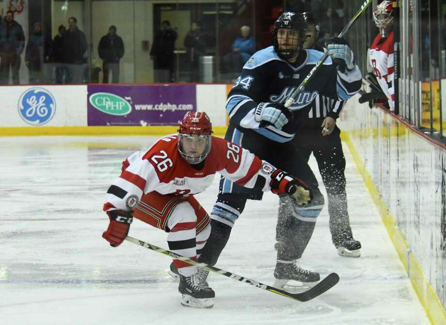 Rensselaer Polytechnic Institute forward Jake Marrello watches the puck after it is passed by University of Maine forward Eduards Tralmaks during a game at RPI campus on Saturday, Dec. 30, 2017, in Troy, N.Y. (Jenn March/Special to the Times Union) Photo: Jenn March / © Jenn March 2017-18 © Albany Times Union 2017-18