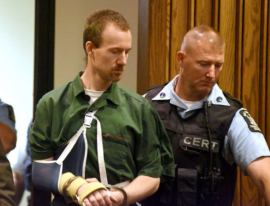 David Sweat is lead into Clinton County Court Thursday, Aug.20, 2015 in Plattsburgh, N.Y. Sweat, a convicted killer who escaped June 6 from the Clinton Correctional Facility and spent more than three weeks on the run was arraigned Thursday on criminal charges stemming from the breakout. Sweat pleaded not guilty to first-degree escape and promoting prison contraband. He is due back in court on September 29. (Rob Fountain/Press-Repub-lican via AP)