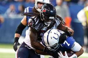 Houston Texans outside linebacker Jadeveon Clowney (90) sacks Indianapolis Colts quarterback Jacoby Brissett (7) during the first quarter of an NFL football game at Lucas Oil Stadium on Sunday, Dec. 31, 2017, in Indianapolis.