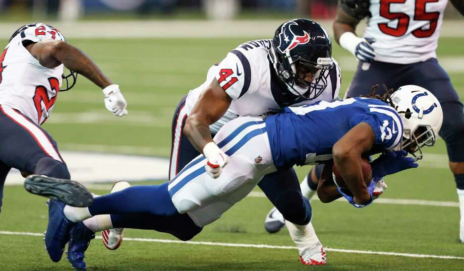 Houston Texans inside linebacker Zach Cunningham (41) stops Indianapolis Colts wide receiver T.Y. Hilton (13) during the first quarter of an NFL football game at Lucas Oil Stadium on Sunday, Dec. 31, 2017, in Indianapolis. Photo: Brett Coomer, Houston Chronicle / © 2017 Houston Chronicle