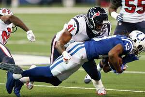 Houston Texans inside linebacker Zach Cunningham (41) stops Indianapolis Colts wide receiver T.Y. Hilton (13) during the first quarter of an NFL football game at Lucas Oil Stadium on Sunday, Dec. 31, 2017, in Indianapolis.