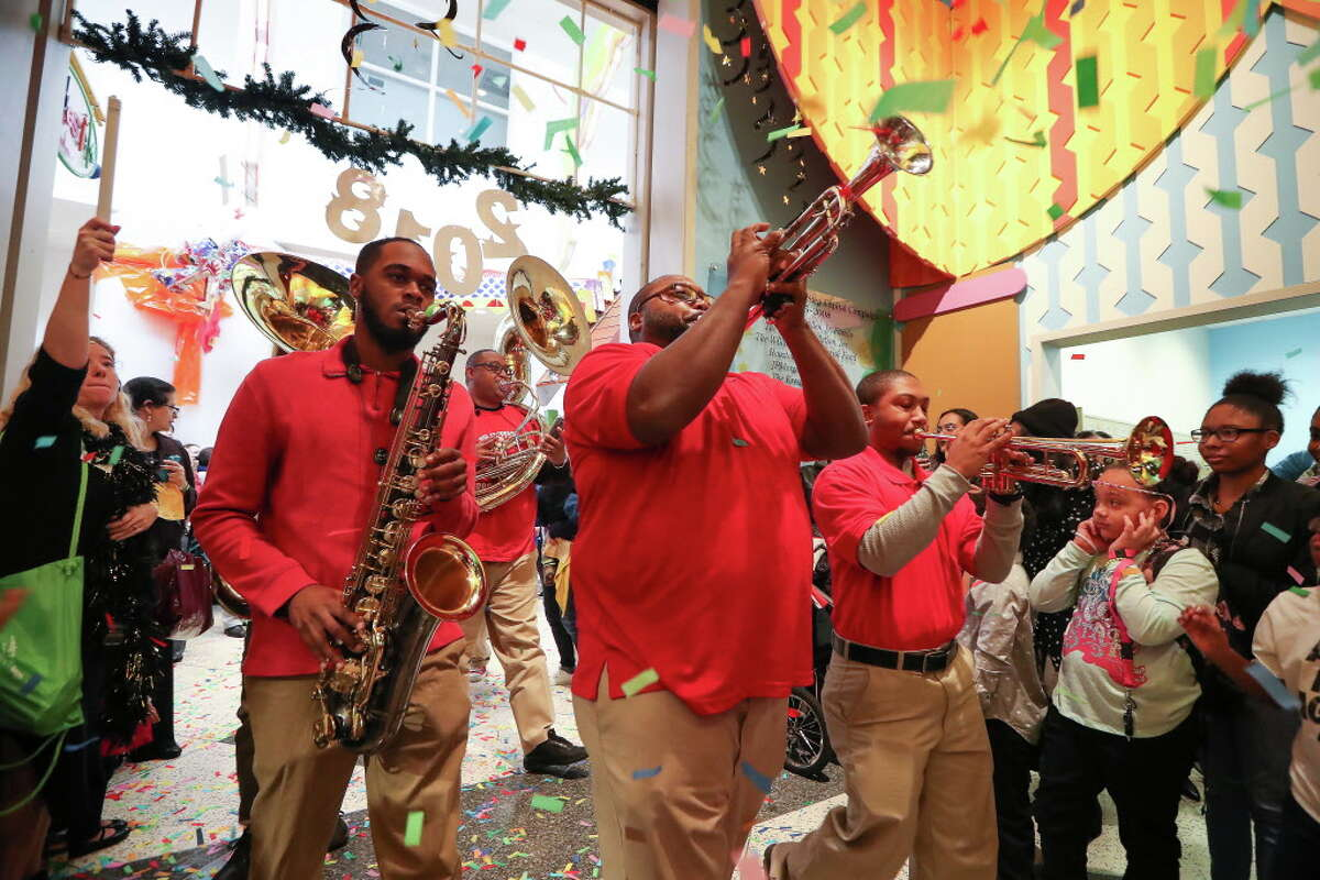 The High Steppers Brass Band led a parade during The Children's Museum of Houston's Rockin' New Year's Noon Bash Sunday, Dec. 31, 2017, in Houston. The event is the city's longest-running New Year's Eve celebration just for kids. This end-of-year bash rings in the New Year at the stroke of noon with a parade and shimmering ball drop.