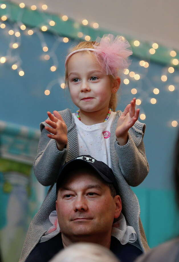Elizabeth Baudin, 4, enjoys the view from her father's, Brandon, shoulders during The Children's Museum of Houston's Rockin' New Year's Noon Bash Sunday, Dec. 31, 2017, in Houston. The event is the city's longest-running New Year's Eve celebration just for kids. This end-of-year bash rings in the New Year at the stroke of noon with a parade and shimmering ball drop. Photo: Steve Gonzales, Houston Chronicle / © 2017 Houston Chronicle