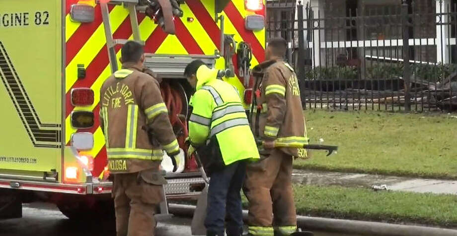 A woman was rescued from a burning apartment in northern Harris County early Sunday. Photo: Metro Video