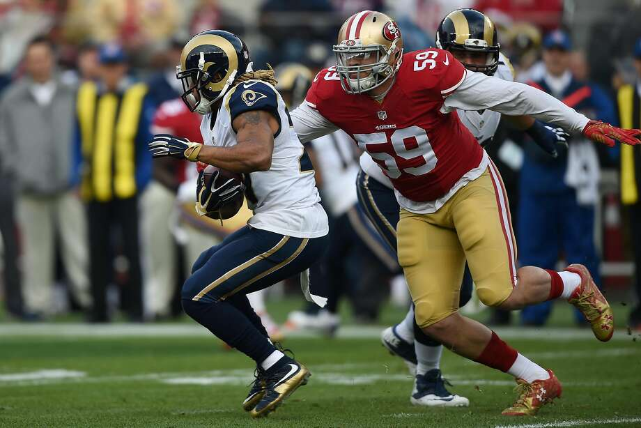 SANTA CLARA, CA - JANUARY 03:  Tre Mason #27 of the St. Louis Rams rushes with the ball as Aaron Lynch #59 of the San Francisco 49ers looks to tackle during their NFL game at Levi's Stadium on January 3, 2016 in Santa Clara, California.  (Photo by Thearon W. Henderson/Getty Images) Photo: Thearon W. Henderson, Getty Images