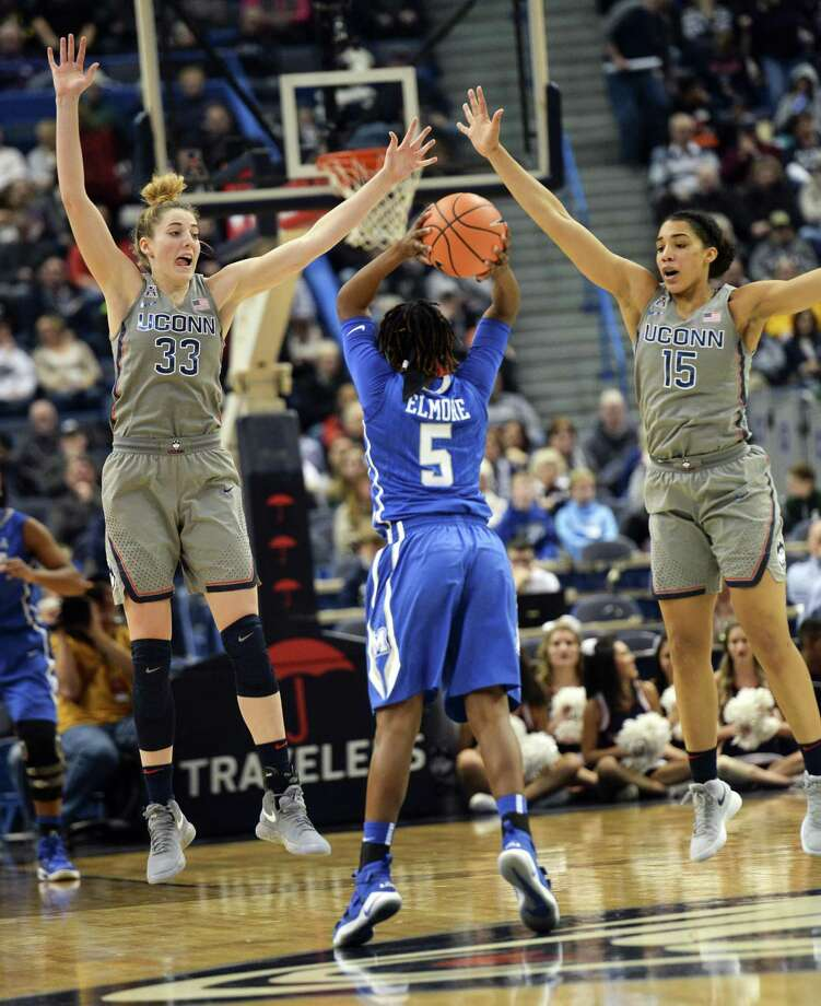 UConn's Katie Lou Samuelson, left, and Gabby Williams guard Memphis' Brea Elmore in the first half Sunday in Hartford. Photo: Stephen Dunn / Associated Press / FR171426 AP