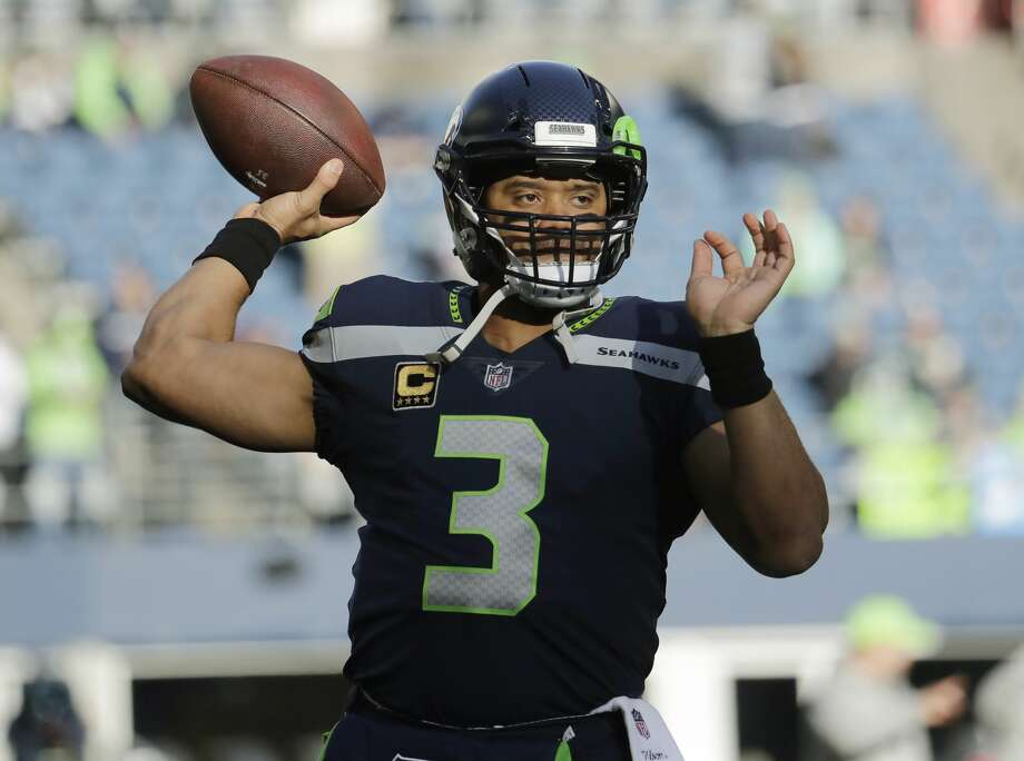 Seattle Seahawks quarterback Russell Wilson passes during warmups before an NFL football game against the Arizona Cardinals, Sunday, Dec. 31, 2017, in Seattle. Photo: Elaine Thompson/AP