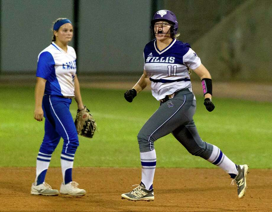 Rachel Brown #11 of Willis celebrates after her walk-off, two-run homer during the ninth inning in Game 3 of a Region III-5A final high school softball series at Cougar Softball Stadium, Saturday, May 27, 2017, in Houston. Willis defeated Barbers Hill 5-3. Photo: Jason Fochtman, Staff Photographer / Stratford Booster Club