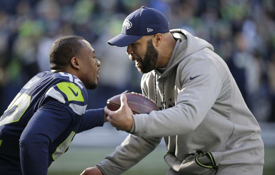 Seahawks defensive coordinator Kris Richard greets strong safety Delano Hill (42) before an NFL football game against the Arizona Cardinals, Sunday, Dec. 31, 2017, in Seattle. Photo: AP Photo/John Froschauer
