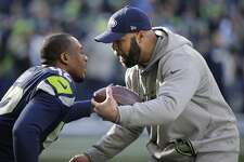 Seahawks defensive coordinator Kris Richard greets strong safety Delano Hill (42) before an NFL football game against the Arizona Cardinals, Sunday, Dec. 31, 2017, in Seattle.
